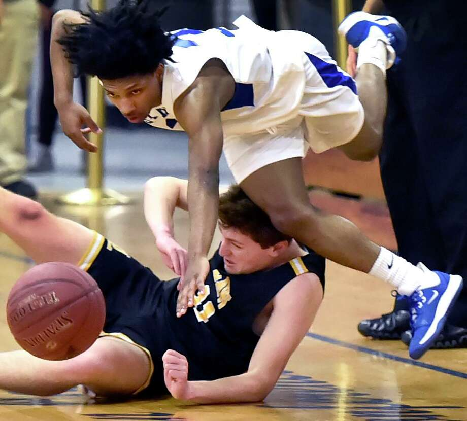 West Haven's Khalel Francis, top, and Law's Noah Tutlis collide as they chase the ball down during the first quarter on Friday. Photo: Peter Hvizdak / Hearst Connecticut Media / New Haven Register