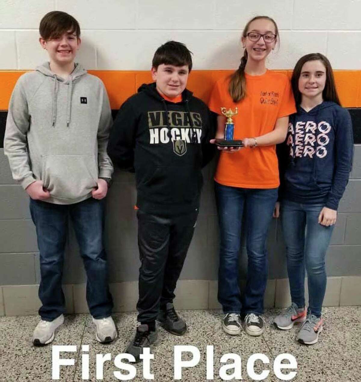 Harbor Beach Middle School students present a first place trophy from a recent quiz bowl competition at Ubly. (Submitted/Torri Volmering)