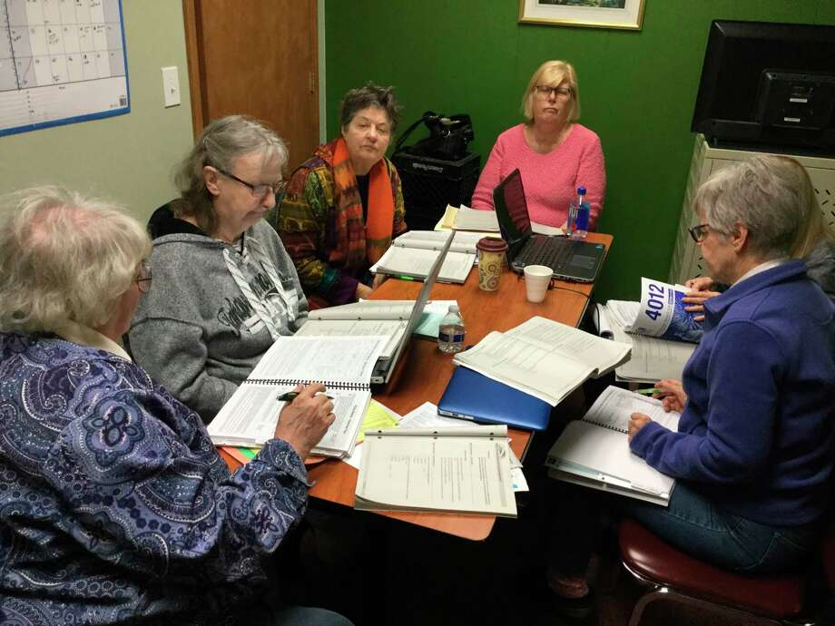 This year's hard-working income tax volunteers get ready for the tax season at the senior center. (Courtesy Photo)
