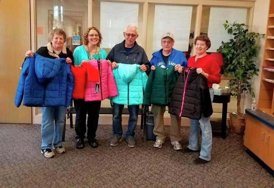Studley Grange members pose with coats the club donated to Pine River Elementary School. (Photo provided)