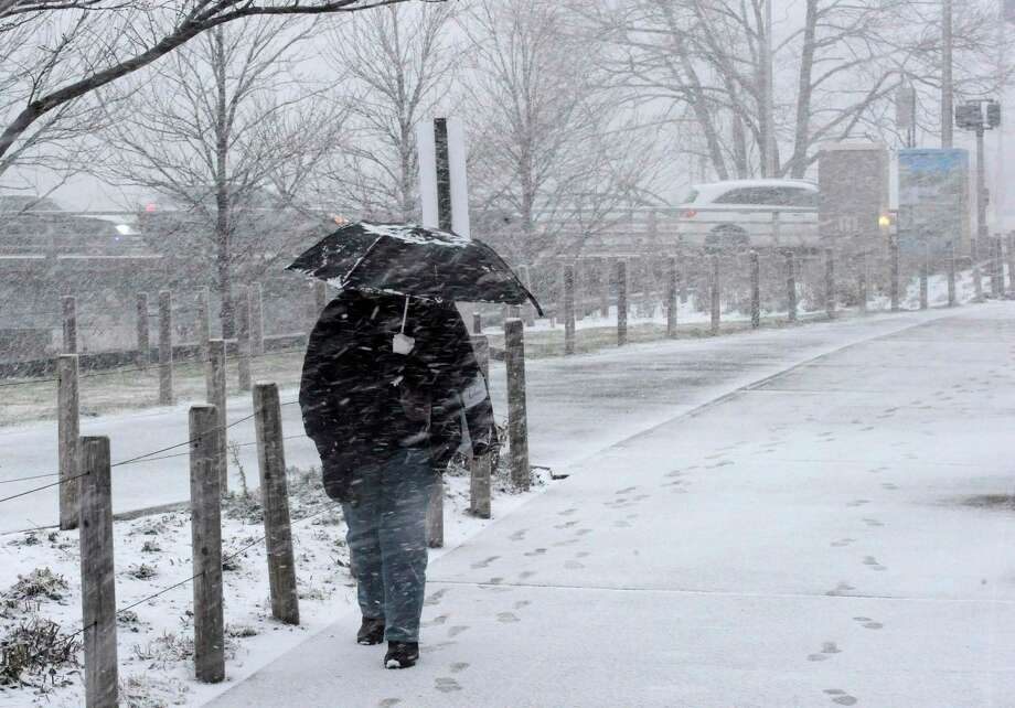In this file photo, a pedestrian makes their way through winter weather as they walk south along Washington Blvd. in Stamford, Conn. on Dec. 18, 2019. Photo: Matthew Brown / Hearst Connecticut Media / Stamford Advocate