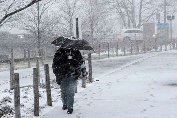In this file photo, a pedestrian makes their way through winter weather as they walk south along Washington Blvd. in Stamford, Conn. on Dec. 18, 2019.