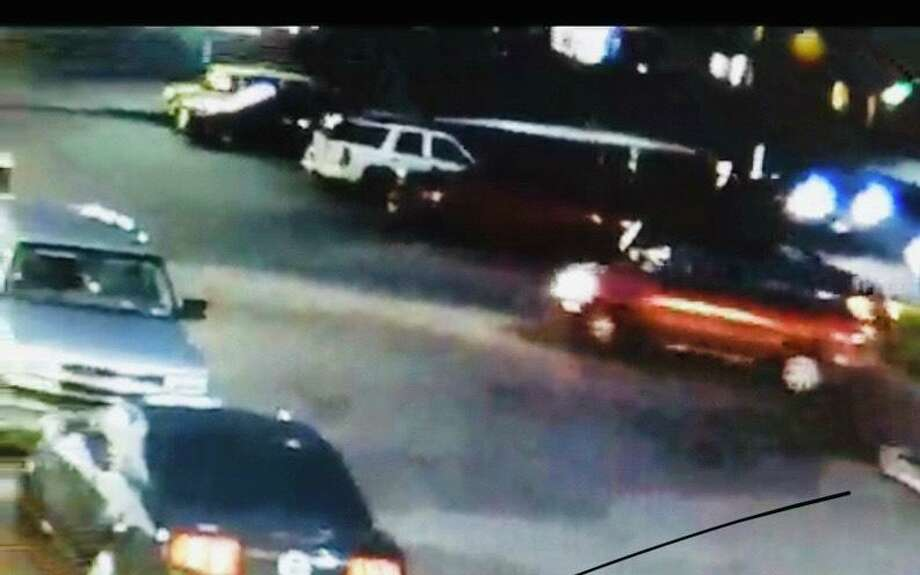 This still image from video surveillance shows a driver fleeing the scene of an accident in which a pedestrian was struck and killed. Photo: Photo Courtesy Of The Fort Bend County Sheriff's Office