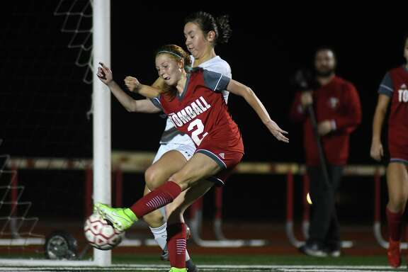 Tomball's Kendall Hall (2) works for a shot on goal against a Huntsville defender during the first period of their matchup at Tomball ISD Stadium on Jan. 14, 2020.