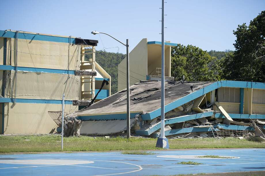 A 6.4 magnitude quake collapsed portions of the three-story Agripina Seda school in the southern coastal city of Guanica on Jan. 7. Schools deemed safe are to reopen on Jan. 27 and 28. Photo: Eric Rojas / Getty Images