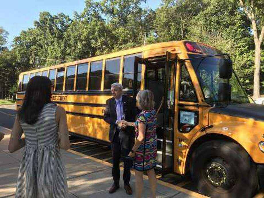 Dr. Alan Addley greeted Tokeneke School staff on the first day of school in 2019 after taking the bus with kindergaretners. Photo: Susan Shultz /Hearst Connecticut Media /