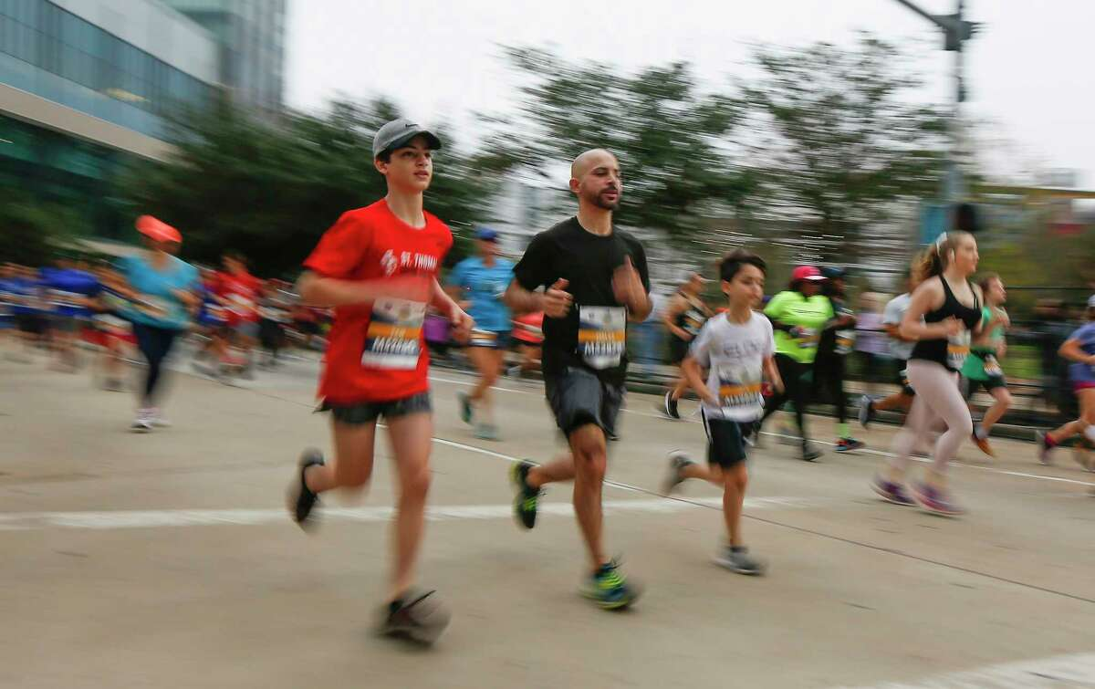Runners make their way down McKinney Street from the starting line of the Houston 5K presented by Chevron & Aramco Saturday, Jan. 18, 2020, in Houston.