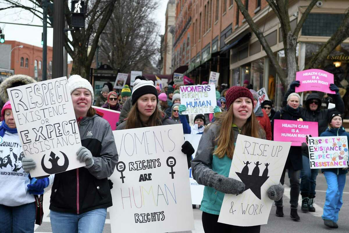 From left to right, sisters Maggie, Abby, and Emma Anthes lead the Women's March they organized down Broadway Ave. in downtown Saratoga Springs, N.Y. to its conclusion at Congress Park on Saturday, Jan 18, 2020. (Jenn March, Special to the Times Union )