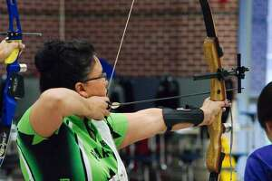 Regina Carrillo participates in the archery event at the Texas Amateur Athletic Federation (TAAF) Winter Games 2020 in Pearland.