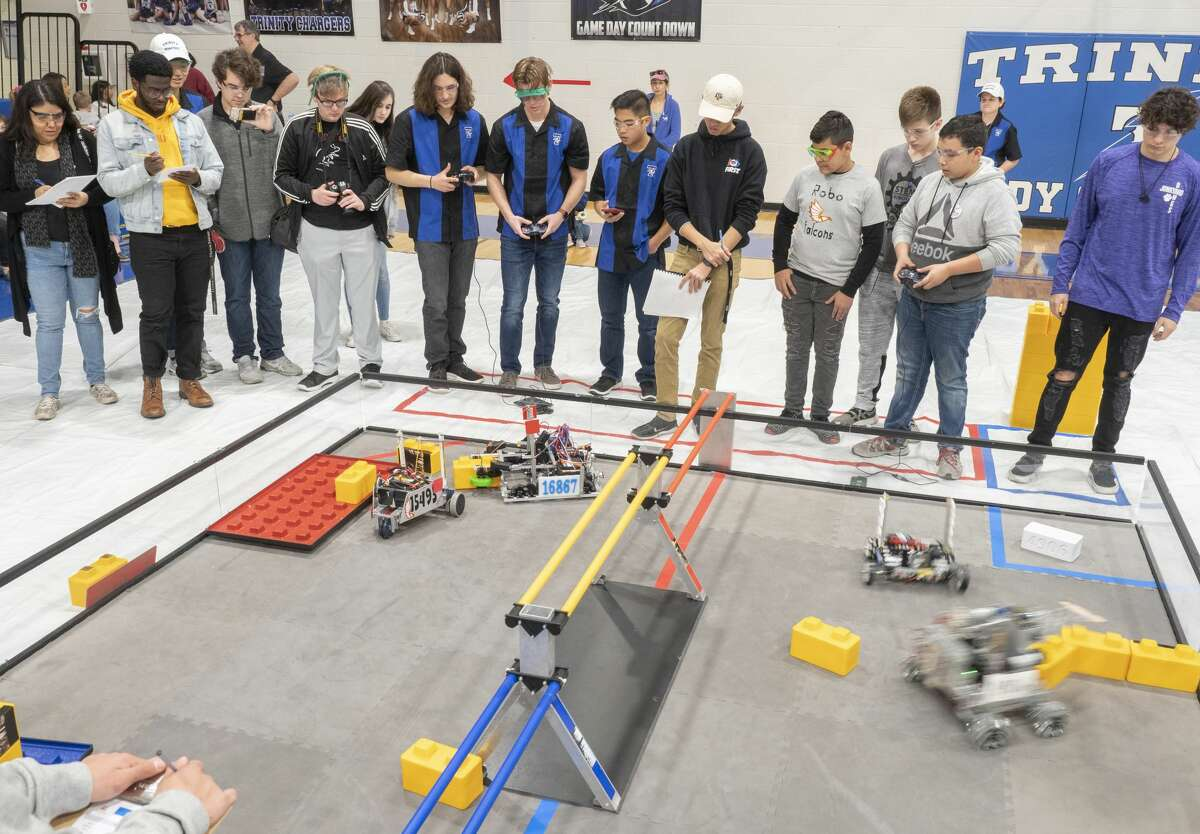 Trinity team members, Trinity Chargers, compete with UTPB STEM Academy team members, Robo Falcons 01/18/2020 during the First Tech Challenge, SkyStone, building a structure on a platform in Beal Gym at Trinity School. Tim Fischer/Reporter-Telegram