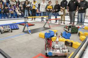 Members of Andrews' Bots in Black and Andrews' Tech-Knights work together in one of the competitions 01/18/2020 during the First Tech Challenge, SkyStone, building a structure on a platform in Beal Gym at Trinity School. Tim Fischer/Reporter-Telegram