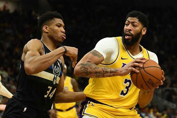MILWAUKEE, WISCONSIN - DECEMBER 19: Anthony Davis #3 of the Los Angeles Lakers is defended by Giannis Antetokounmpo #34 of the Milwaukee Bucks during the second half of a game at Fiserv Forum on December 19, 2019 in Milwaukee, Wisconsin. (Photo by Stacy Revere/Getty Images)