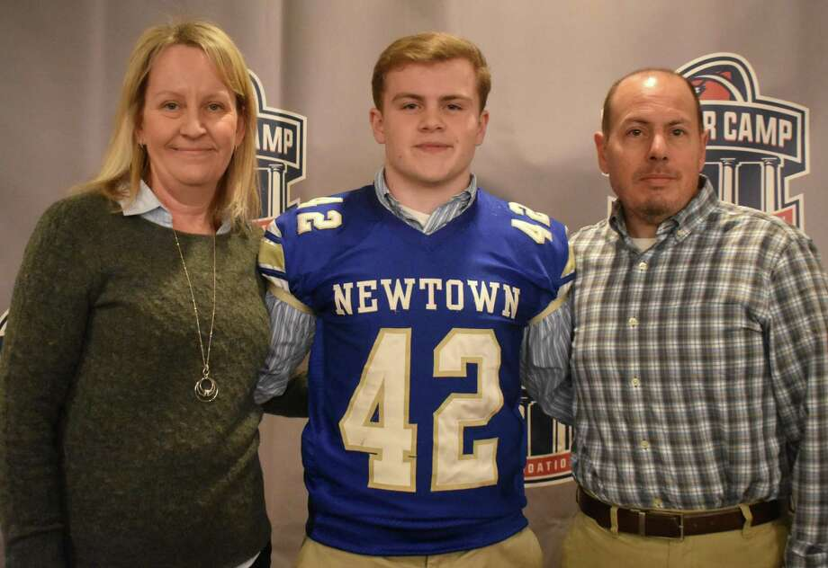 Newtown's Ben Pinto poses with his parents after winning the Generation UCan Inspire Award at the Walter Camp 13th Annual Breakfast of Champions on Saturday, January 18, 2020. (Pete Paguaga, Hearst Connecticut Media)