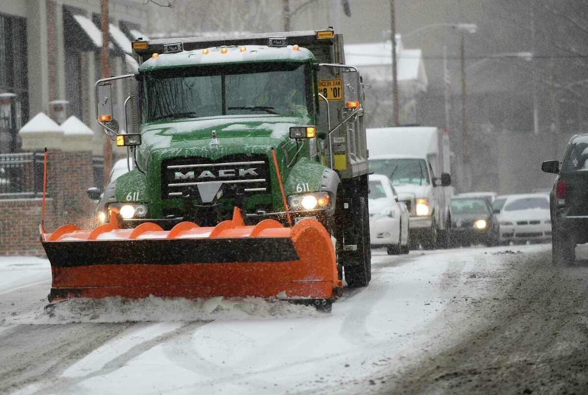 DPW plow trucks deal with the snow on Washington Street Saturday, Januray 18, 2020, in Norwalk, Conn.