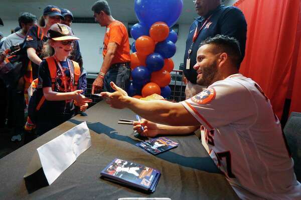 Jose Altuve signed autographs for young fans during FanFest at Minute Maid Park Saturday, Jan. 18, 2020, in Houston.