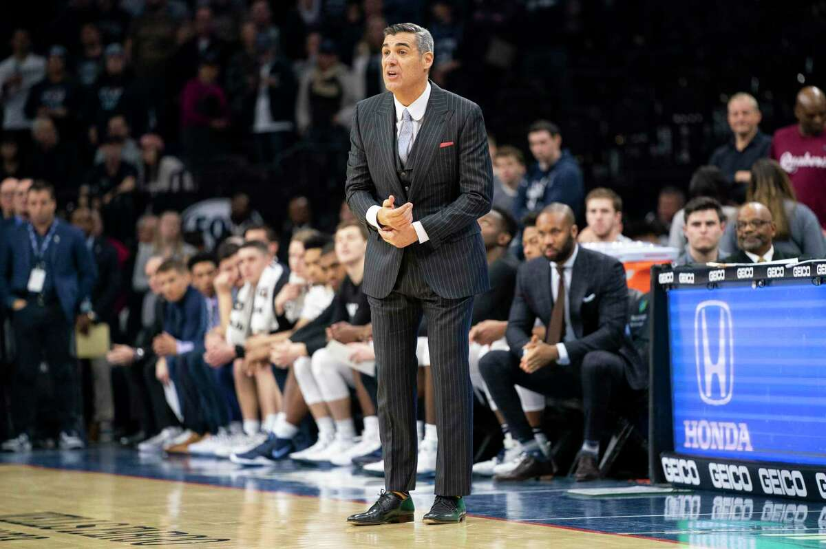 Villanova's head coach Jay Wright looks on from the sidelines during the first half of an NCAA college basketball game against Connecticut, Saturday, Jan. 18, 2020, in Philadelphia. Villanova won 61-55. (AP Photo/Chris Szagola)