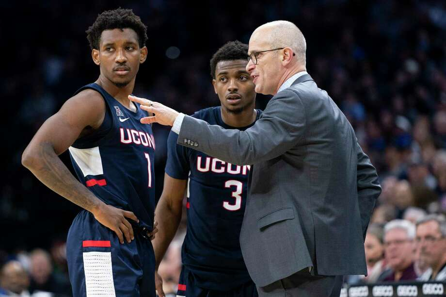 Connecticut head coach Dan Hurley, right, talks things over with Christian Vital, left, and Alterique Gilbert, center, during the second half of an NCAA college basketball game against Villanova, Saturday, Jan. 18, 2020, in Philadelphia. Villanova won 61-55. (AP Photo/Chris Szagola) Photo: Chris Szagola / Associated Press / Copyright 2020 The Associated Press. All rights reserved.