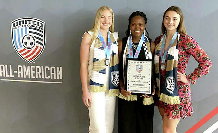 Junior College National Player of the Year Boitumelo Rabale of LCCC, center, is joined by All-America LC teammates Candice Parziani, left and Cassie Hall Saturday at the annual United Soccer Coaches All-America Ceremony and Reception at the United Soccer Coaches Convention in Baltimore.