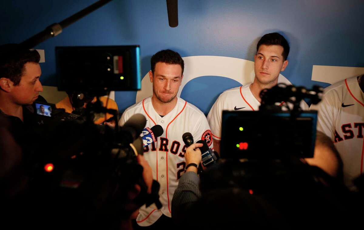 Alex Bregman is interviewed by the media during FanFest at Minute Maid Park Saturday, Jan. 18, 2020, in Houston. Kyle Tucker is on the right.
