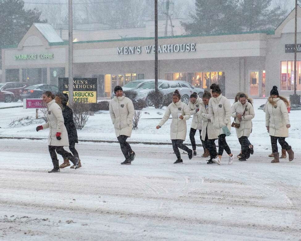 The Liberty Synchronized Skating Team crosses Wolf Road during a snow storm on Saturday, Jan. 18, 2019 (Jim Franco/Special to the Times Union.)