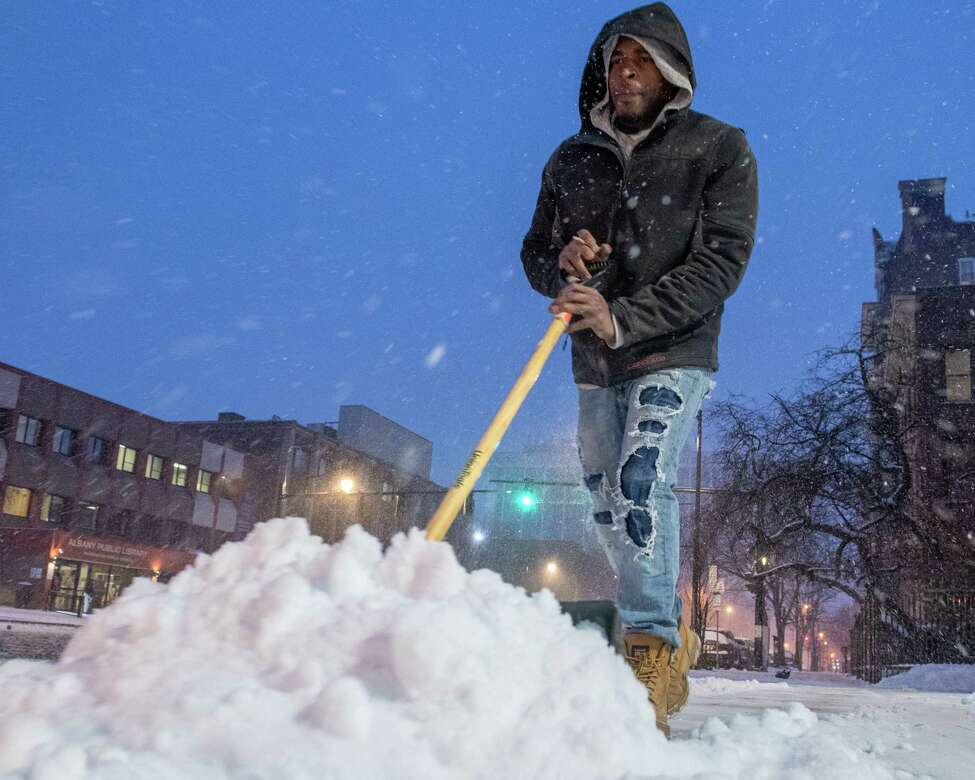 Shawn Davis shovels snow outside 194 Washington Ave. in Albany NY on Saturday, Jan. 18, 2019 (Jim Franco/Special to the Times Union.)