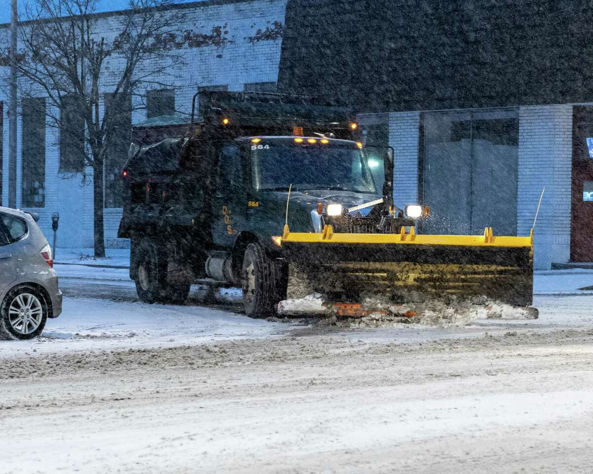 Snow plows were out Thursday morning as a mix of snow, sleet and rain hit the area overnight. In this photograph, a plow turns on Central Avenue in Albany on Saturday, Jan. 18, 2019 (Jim Franco/Special to the Times Union.)