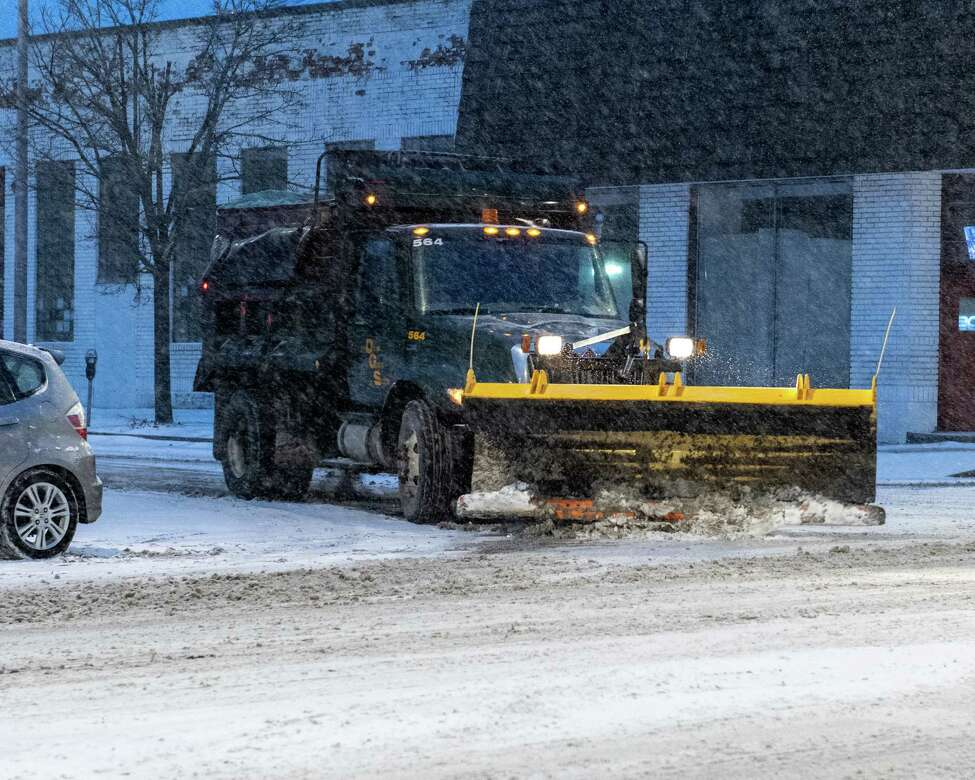 A snow plow turns on Central Avenue in Albany on Saturday, Jan. 18, 2019 (Jim Franco/Special to the Times Union.)