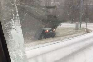 A vehicle off the road in Wallingford, Conn., shortly after the snow started to fall on Saturday, Jan. 18, 2020.