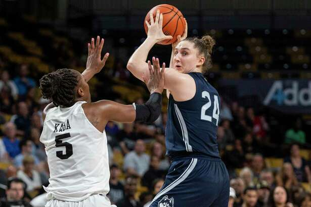 Connecticut guard Anna Makurat (24) looks for a passing lane against Central Florida forward Masseny Kaba (5) during the second half of an NCAA college basketball game in Orlando, Fla., Thursday, Jan. 16, 2020.