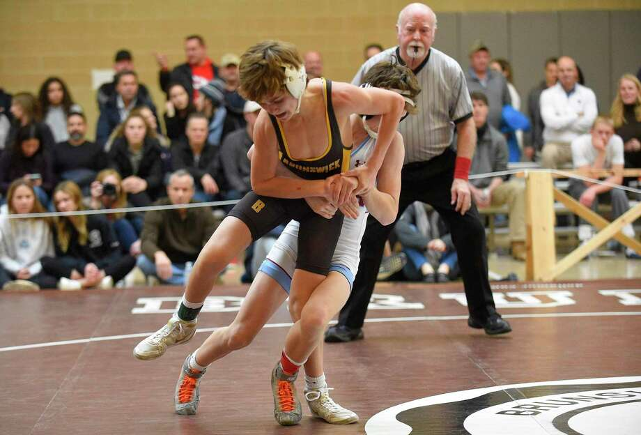 Brunswick's Kyle Pagnani wrestles in the finals of the 108-pound weight division of the Brunswick Invitational against Northfield Mount Hermon's Aaron Burstein on Saturday. Photo: Matthew Brown / Hearst Connecticut Media / Stamford Advocate