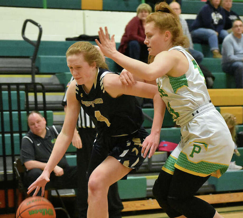 Father McGivney guard Anna McKee, left, tries to drive past Southwestern guard Rylee Smith in the second quarter of Saturday's game in Piasa. Photo: Matt Kamp|The Intelligencer
