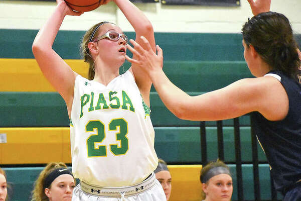 Southwestern forward Annie Gallaher looks for an open teammate from the corner during the third quarter of Saturday's game against Father McGivney in Piasa.