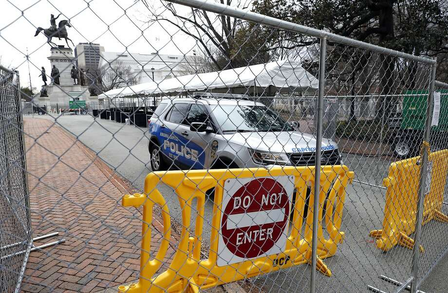 Barriers are set up at the Virginia State Capitol in Richmond on Saturday, Jan. 18, 2019, in anticipation of a rally by a large number of gun-rights backers on Monday. An unprecedented show of force by gun-rights activists is expected on Monday in Virginia. They are angry over the state's new Democratic majority leadership and its plans to enact a slew of gun restrictions. Thousands of gun activists are expected to turn out. Second Amendment groups have identified the state as a rallying point for the fight against what they see as a national erosion of gun rights. (Joe Mahoney/Richmond Times-Dispatch via AP) Photo: Joe Mahoney / Richmond Times-Dispatch