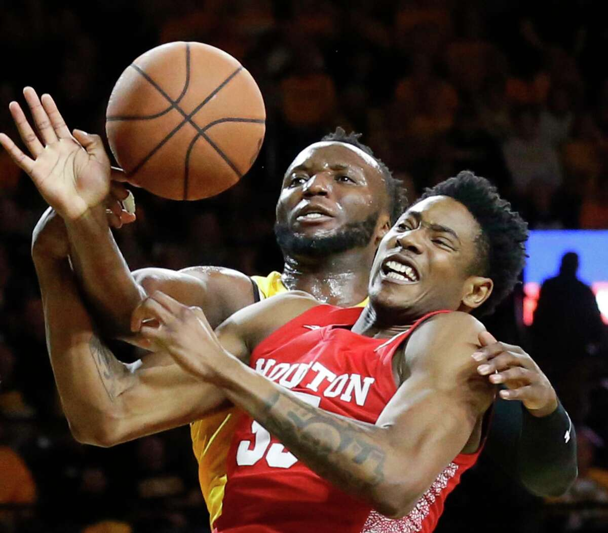 Wichita State center Morris Udeze, left, fights for a ball with Houston center Brison Gresham (55) during first-half NCAA college basketball game action Saturday, Jan. 18, 2020, in Wichita, Kan. (Bo Rader/The Wichita Eagle via AP)