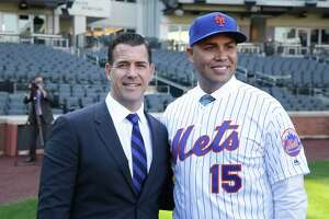 The New York Mets new manager, Carlos Beltran, right, poses for a picture with general manager Brodie Van Wagenen after a news conference at Citi Field in 2019, in New York.