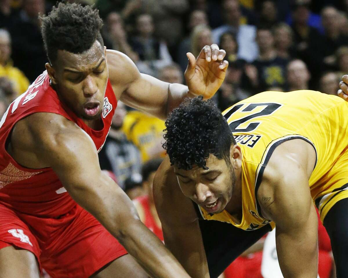 Houston forward Fabian White Jr. (35) battles for a rebound with Wichita State forward Jaime Echenique (21) under the Shocker basket Saturday in Koch Arena on January 18, 2020. (Bo Rader/Wichita Eagle/TNS)