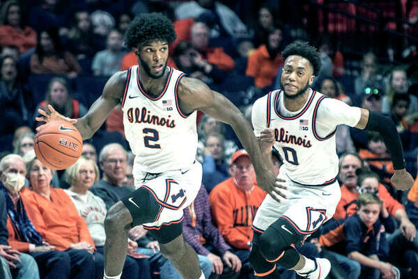 Illinois' Kipper Nichols heads down court with teammate Alan Griffin after stealing the ball Saturday against Northwestern in Champaign.