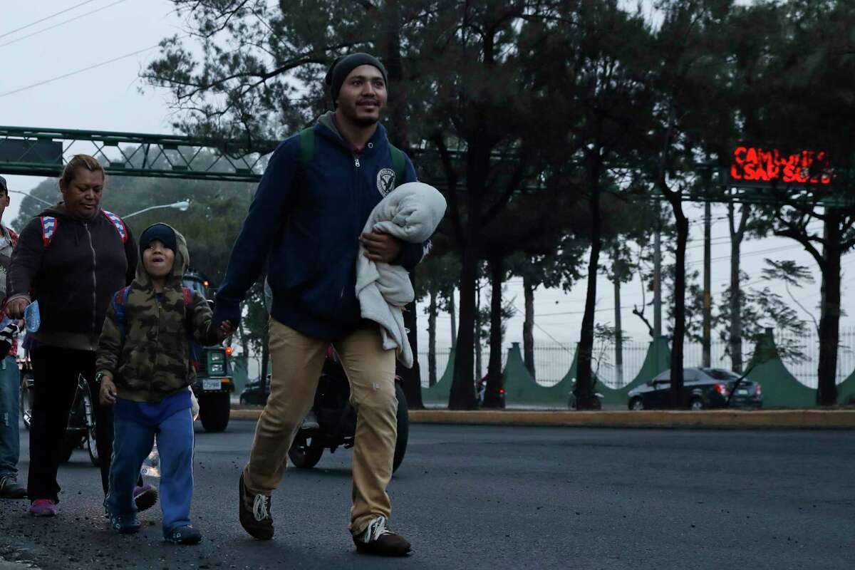 Honduran migrants resume they journey in hopes of reaching the United States after sleeping in Guatemala City, Saturday, Jan. 18, 2020. Guatemalan officials had counted more than 3,000 migrants who registered at border crossings to enter the country in recent days and there were additional migrants who did not register. (AP Photo/Moises Castillo)