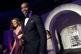 Pro Football Hall of Famer Curtis Martin is introduced at the 53rd Annual Walter Camp Football Foundation Awards Dinner at Yale University on Saturday.