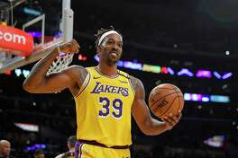 Los Angeles Lakers center Dwight Howard gestures after forward LeBron James scored during the second half of an NBA basketball game against the Cleveland Cavaliers Monday, Jan. 13, 2020, in Los Angeles. The Lakers won 128-99. (AP Photo/Mark J. Terrill)