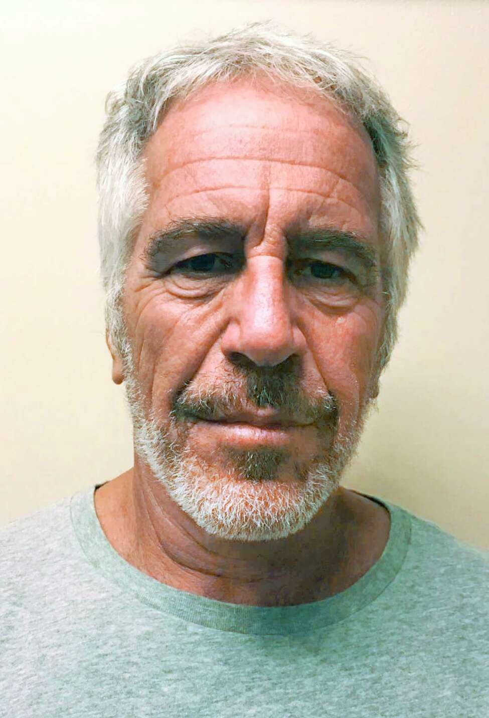 FILE -- A photo provided by the New York State Sex Offender Registry shows Jeffrey Epstein on March 28, 2017. New evidence shows Epstein sexually abused and trafficked hundreds of young women and girls on his private Caribbean island, some as recently as 2018, significantly expanding the scope of his alleged conduct, a top law enforcement official said in a lawsuit filed on Jan. 15, 2020. (New York State Sex Offender Registry via The New York Times) -- FOR EDITORIAL USE ONLY. --