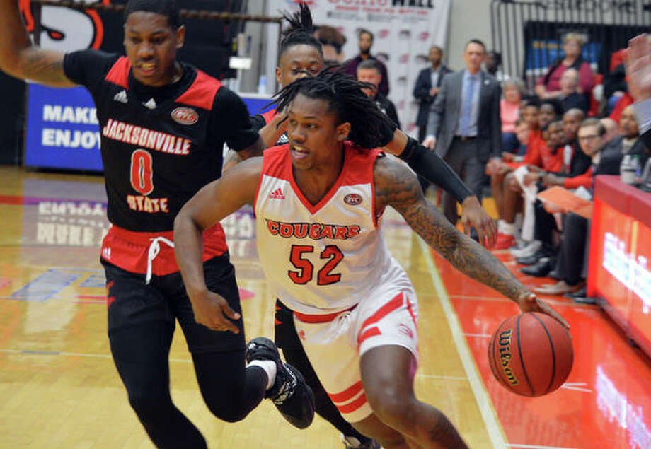 SIUE's Iziah James drives past a Jacksonville State defender during the first half of Saturday's Ohio Valley Conference game at at the First Community Arena at the Vadalabene Center. Photo: Scott Marion/The Intelligencer