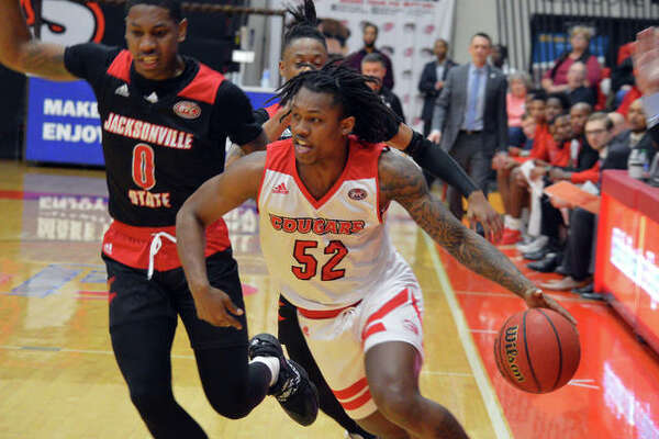 SIUE's Iziah James drives past a Jacksonville State defender during the first half of Saturday's Ohio Valley Conference game at at the First Community Arena at the Vadalabene Center.