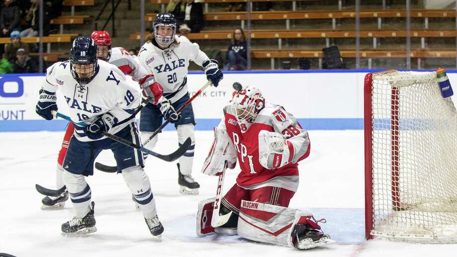RPI goaltender Alec Calvaruso has a bulldog shot deflect of the top of his mask. Photo: Steve Musco / Yale Athletics / © Steve Musco 2019-2020, all rights reserved