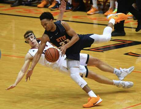 UTEP's Nigel Hawkins (23) collides with UTSA's Erik Czumbel (10) during Conference USA basketball action in the Convocation Center on Saturday, Jan. 18, 2020. Czumbel was called for a foul. UTSA won the game, 86-70.