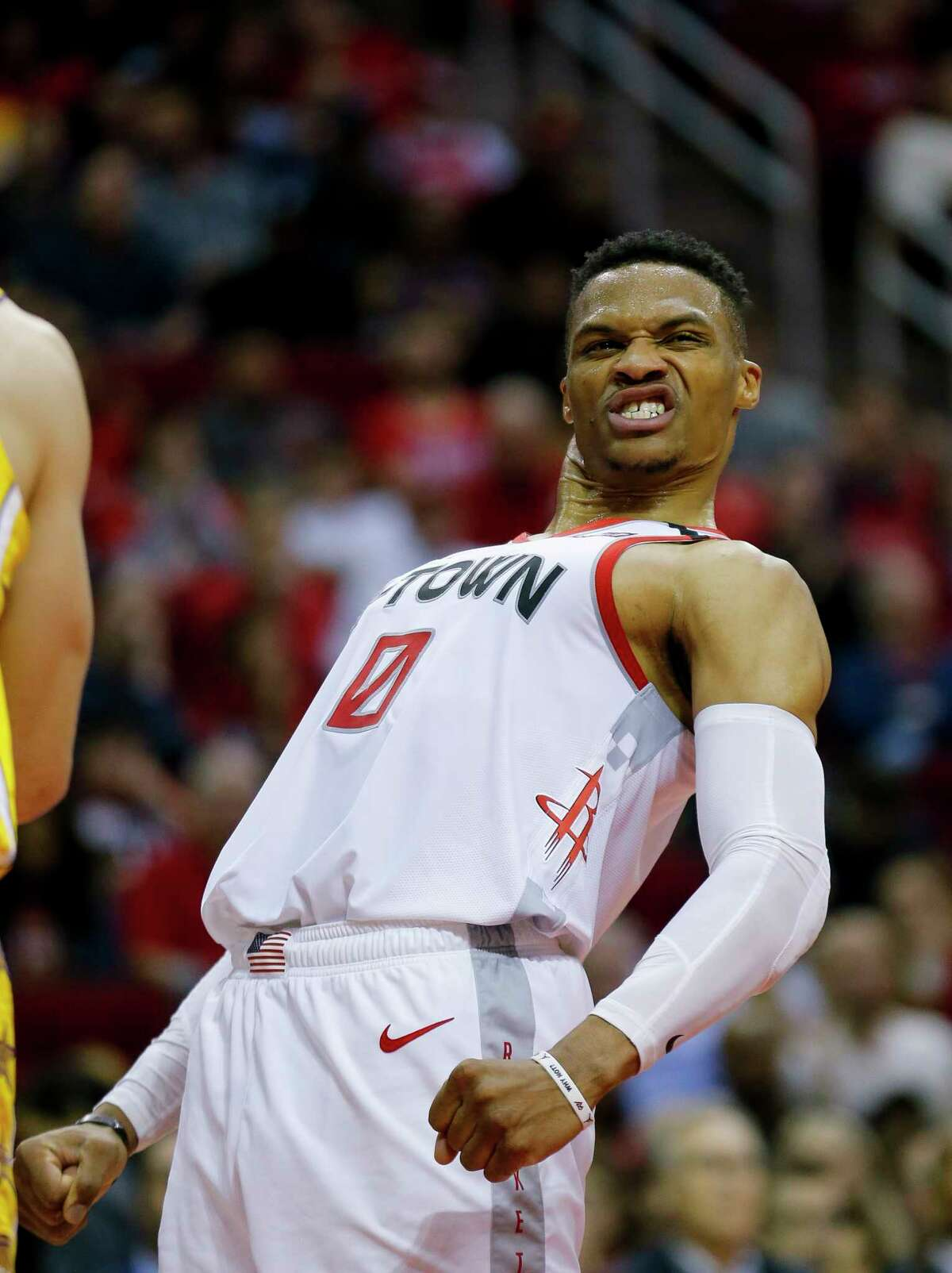 Houston Rockets guard Russell Westbrook (0) reacts after making a basket despite being fouled by Los Angeles Lakers center Dwight Howard (39) during the first half of an NBA game at the Toyota Center on Saturday, Jan. 18, 2020.
