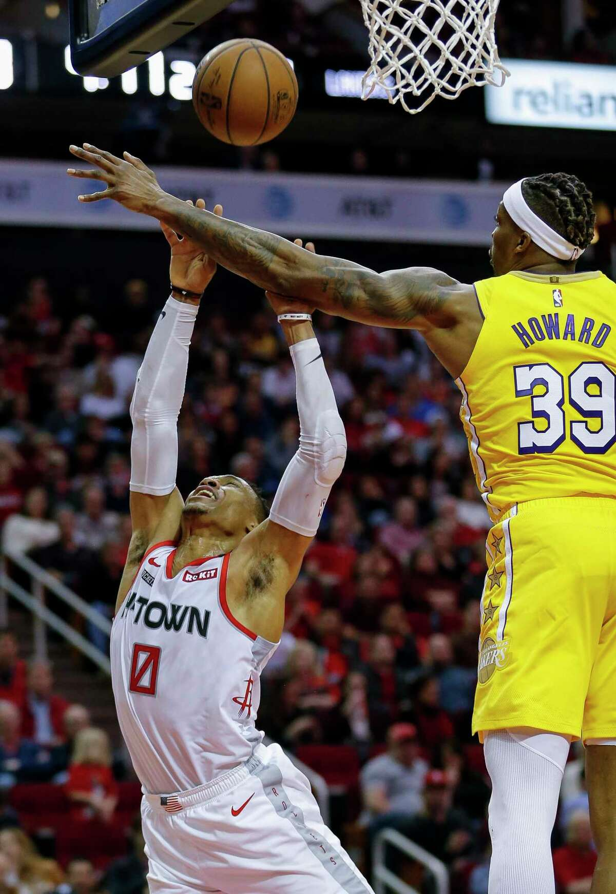Houston Rockets guard Russell Westbrook (0) makes a basket despite being fouled by Los Angeles Lakers center Dwight Howard (39) during the first half of an NBA game at the Toyota Center on Saturday, Jan. 18, 2020.