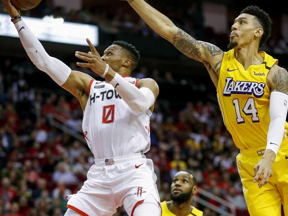 Houston Rockets guard Russell Westbrook (0) scores on a layup against Los Angeles Lakers guard Danny Green (14) during the first half of an NBA game at the Toyota Center on Saturday, Jan. 18, 2020. Photo: Godofredo A. Vásquez/Staff Photographer