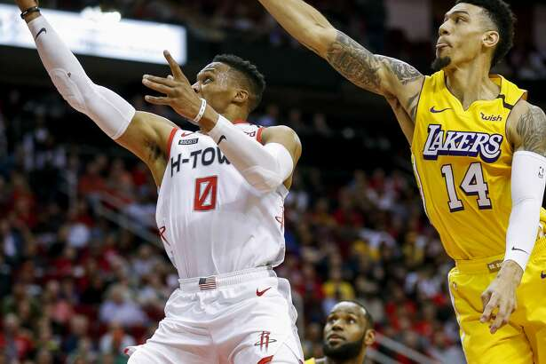 Houston Rockets guard Russell Westbrook (0) scores on a layup against Los Angeles Lakers guard Danny Green (14) during the first half of an NBA game at the Toyota Center on Saturday, Jan. 18, 2020.