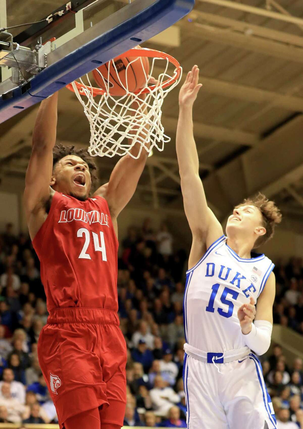DURHAM, NORTH CAROLINA - JANUARY 18: Dwayne Sutton #24 of the Louisville Cardinals dunks the ball against Alex O'Connell #15 of the Duke Blue Devils during their game at Cameron Indoor Stadium on January 18, 2020 in Durham, North Carolina. (Photo by Streeter Lecka/Getty Images)